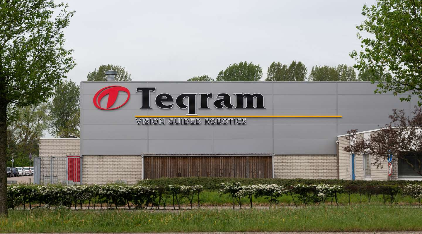 Outside view on the Teqram Building with the logo on the building