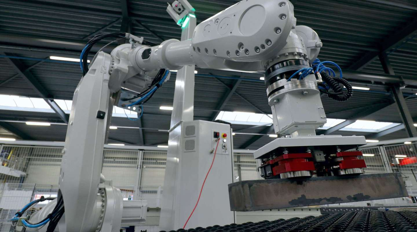 EasyBot picked up a heavy steel product with a magnetic gripper