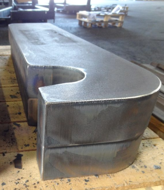 2 Heavy oxy-fuel cut steel products with grinded edges on a pallet