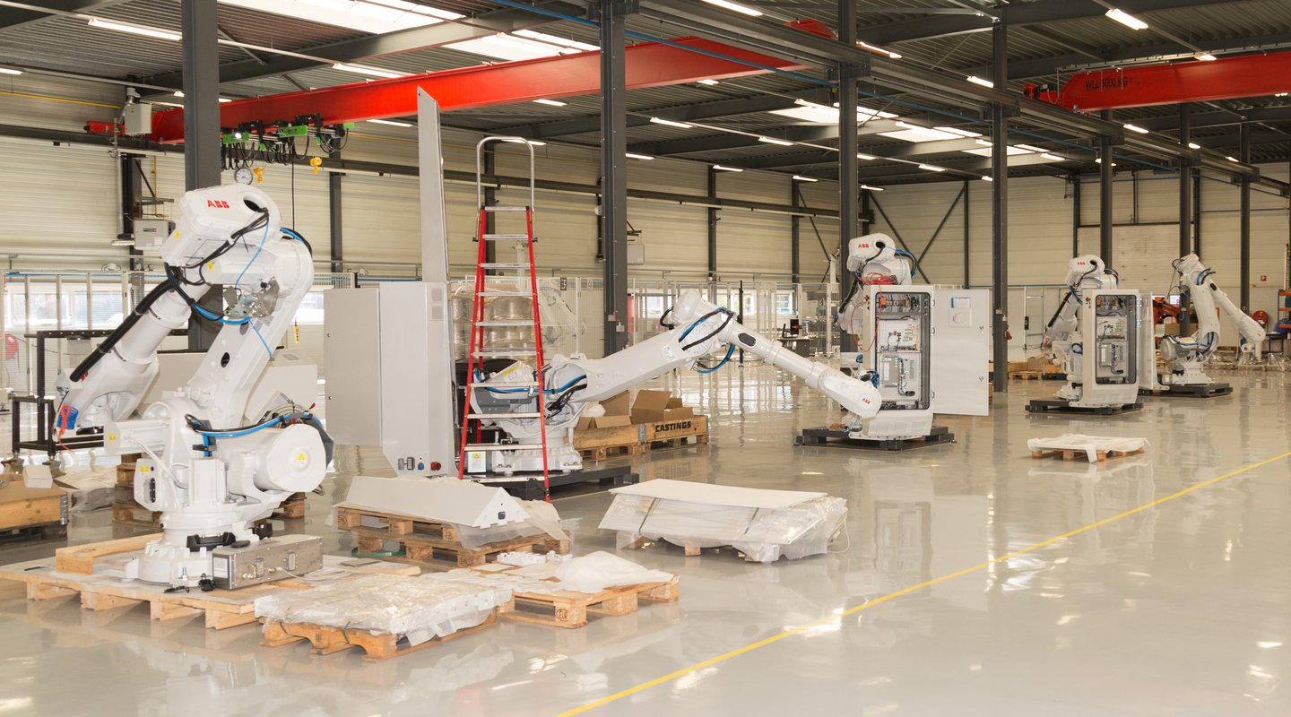 Inside view of the Teqram production area with multiple robots